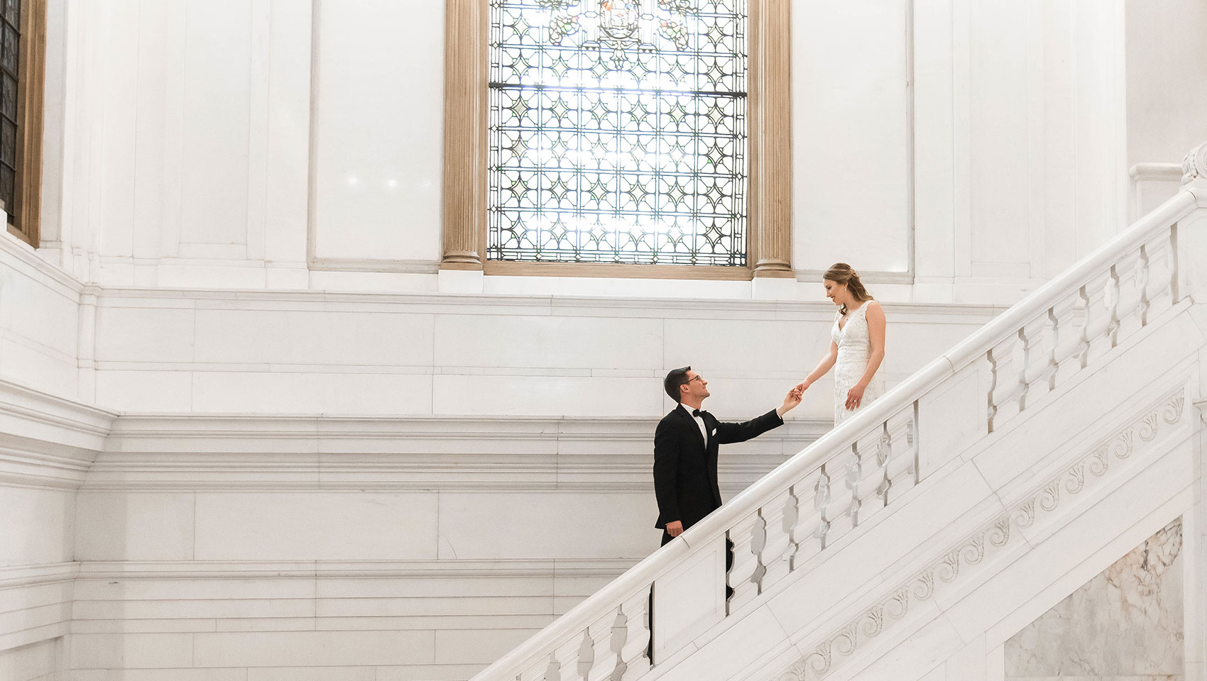 Holding hands on Staircase - JadeNikkolePhotography