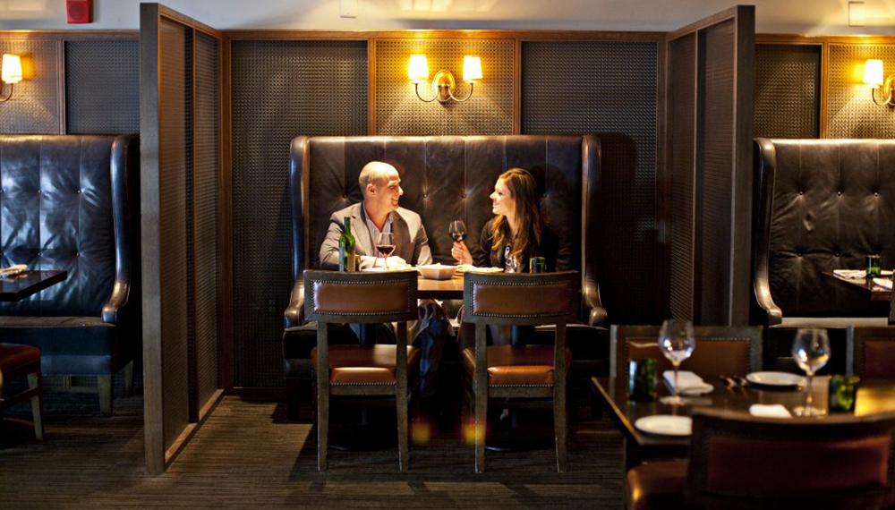 Couple sitting in a booth at B&O American Brasserie in Baltimore